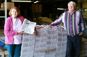 Chritine Beems, Editor in Chief, and Kim Combs,  Publisher & General Manager of Help YourSelf, accept delivery of 20,000 'hot off the press' copies of their Community Resources Directory debut edition.